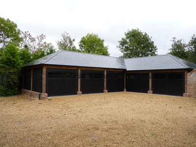 Five garage building outhouse in black architectural design and build